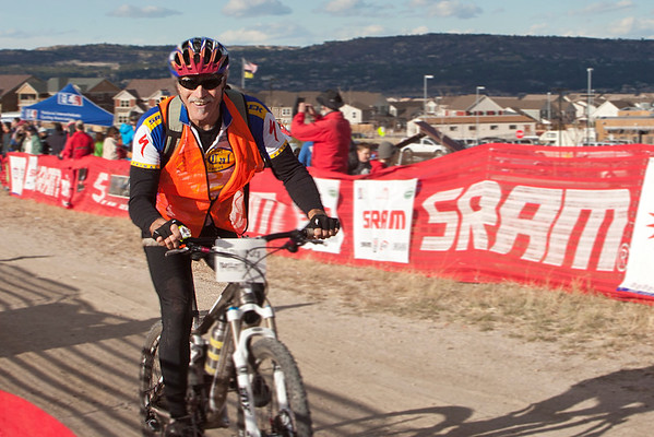 Rick Spittler, President of the National Interscholastic Cycling Association (NICA), flashes a smile as he comes through from marshaling on the course. He flew out from California to join us. Photo Carrie DIttmer.