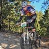Laurel Rathbun (Highlander Composite) tackles sandy descent on Varsity course. Photo Paul Magnuson.