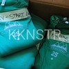 Volunteer t-shirts bundled and ready for distribution