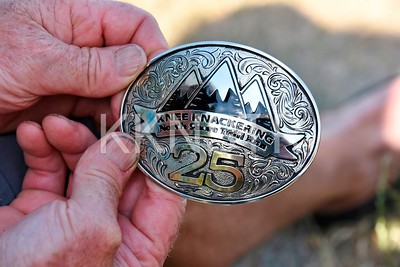 25 year Knee Knacker belt buckle