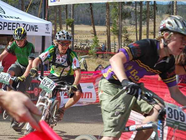 JV riders Jack Dean (right, Boulder HS) and Mark Curie (left, independent) mix it up with Sophomore category winner Isaac Stackonis (center, Salida-BV Composite) as they all start another lap.
