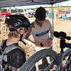 Coach Zach Moore, Salida Buena Vista Composite works on a racers bike.