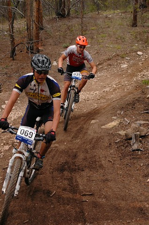 Leadville Varsity racer Darian Fairclough (069) tackles the corner with Max Neuman (036) in hot pursuit. Photo Gilbert Barth.