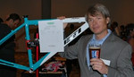 Fort Collins Coach Rob Noble bids on the Yeti ARC frame donated by Yeti Cycles.  Photo by Jake Kirkpatrick.