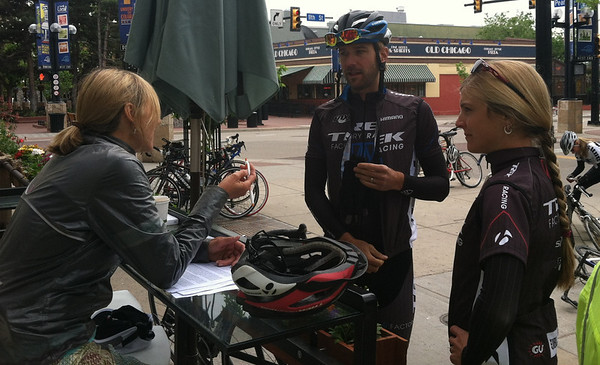 Anita Nebel, event volunteer, catches up with Jeremy and Heather before the Cyclefest ride.