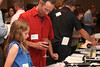 Hal McKelvy and daughter peruse the Silent Auction. Photo Rob Noble.