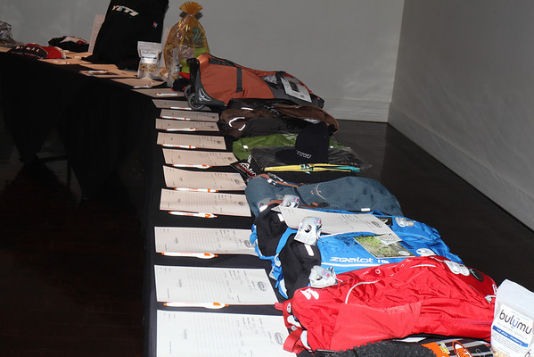 Lots of amazing gear. These Osprey packs were snatched up after competitive bidding. Photo Rob Noble.
