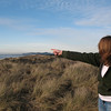 This one is for mom and dad: the point where Sarah is pointing is Fort Canby in WA where we camped last summer, near Ilwaco.