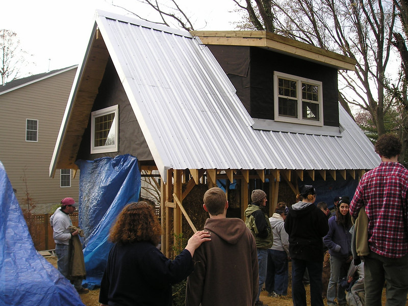 This is the studio we were working on in an Arlington neighborhood.  It already had a wooden frame.  We were just infilling it with strawbales.  Note the small, top area on the roof--they are going to put a green roof there.