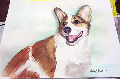 Photo of a watercolor portrait done of a Corgi puppy.