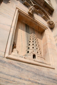 Some of the exterior parts near the doors were scenes of stories from the Bible. Pictured here: Tower of Babel (?).