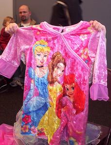 Grandma Trudy, Grandpa Dan and Becca gave Rachel some princess pajamas.
