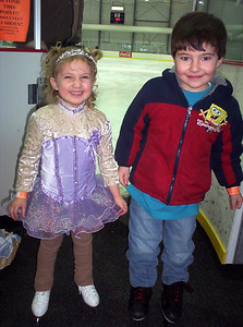 Rachel with next door neighbor Nolan. Nolan is a big hockey fan and he was very excited to try ice skating for the first time. There was a hockey game immediately after Rachel's party, and Rachel's coach arranged for him to meet the players, making it an extra special event for Nolan.