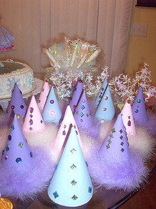 Each year, Rachel picks one party item that she thinks is the most important thing for the party. This year, it was all about party hats. We made special hats for the party, trimmed them in marabou feathers and glued on lots of rhinestones.
