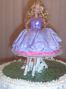 """We made Barbie dress to look like the dress she wears in """"Barbie and the Magic of Pegasus,"""" and also to look like the dress Mommy made for Rachel to wear at the birthday party. Edible glitter and luster dust gave the dress an irridescent sheen."""