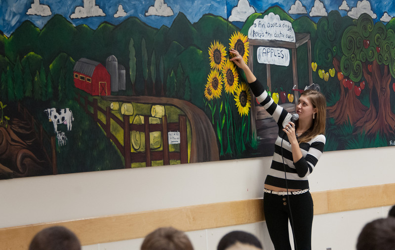 Rachel with 32' mural painted for Fairhaven Middle School 2012
