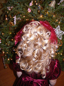 Rachel did a great job and sat very still while Mommy curled her hair -- I think she looked just like a china doll!