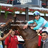 Lady  Eli  exits   the winners circle