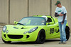 Stuart Maxcy prepping their new Lotus for his dad Doug, seen in the driver's seat