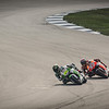 Marc Marquez (93) closes in on Alvaro Bausta entering turn 10 at Indianapolis MotoGP 2013. Marquez eventual winner.