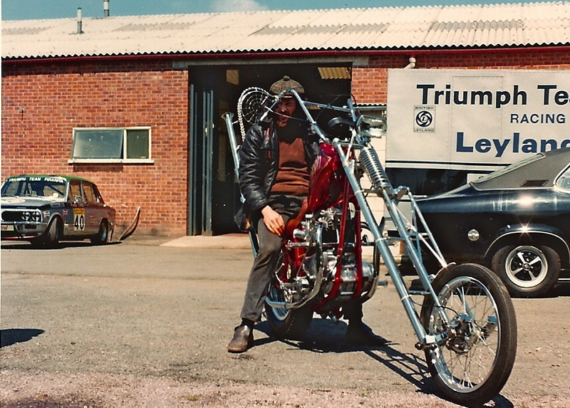 Gilbert Sills Shows Off His Hand Crafted Triumph Chopper Outside The Broadspeed Workshop