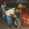 The late Bob Watkins tops up the oil in the dry sump tank.