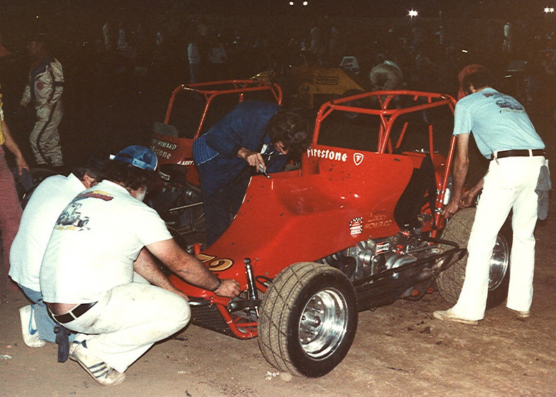 Larry takes a peak down the injectors while Larry Howard & Ron Weeks (at front) discuss suspension tweaks