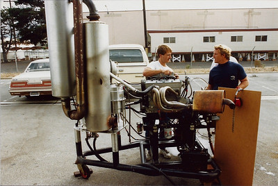 In our early days we did not have a permanent dyno so I helped  build a portable unit so we could run our midget engines outside. Here Roland Grassell and Sleepy Trip (Midget Champion at Ascot Park) test a new exhaust system that Sleepy had built. We used to run this dyno up to 10.000 rpm's
