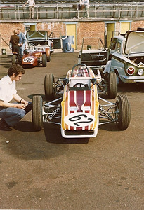 Andy checking the tire pressure prior to practice at Silverstone with my Lotus Cortina in the background. The new paint scheme was designed by Robin Benion but later had to be discarded due to the complexity of fixing after crash damage.