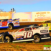 Steve Anderson Jr, Mike Balecaen and Donny Schatz racing 3 wide in their NLRA Late Models at The World Famous Legendary Bullring River Cities Speedway in Grand Forks North Dakota