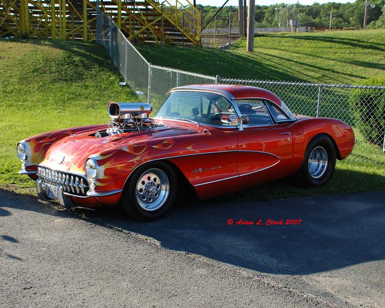 Pro street corvette in the parking lot.