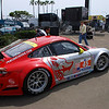 The #45 Flying Lizard machine being pushed to inspection. This car won the GT class in the ALMS race on Saturday