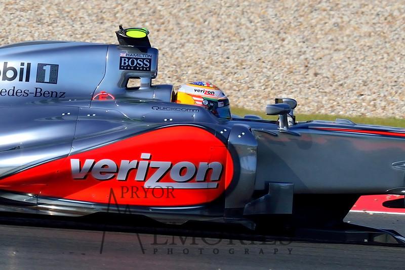 Winner of the 2012 U.S. Formula 1 Grand Prix, Lewis Hamilton, driving the #04 Verizon McClaren Mercedes.