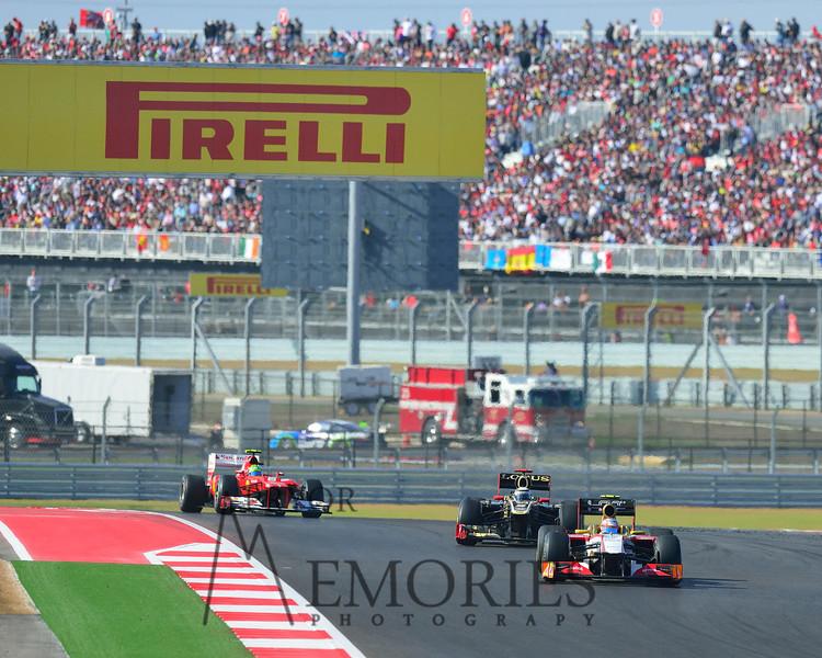 Felipe Massa chasing Kimi Raikkonen chasing Narain Karthikeyan