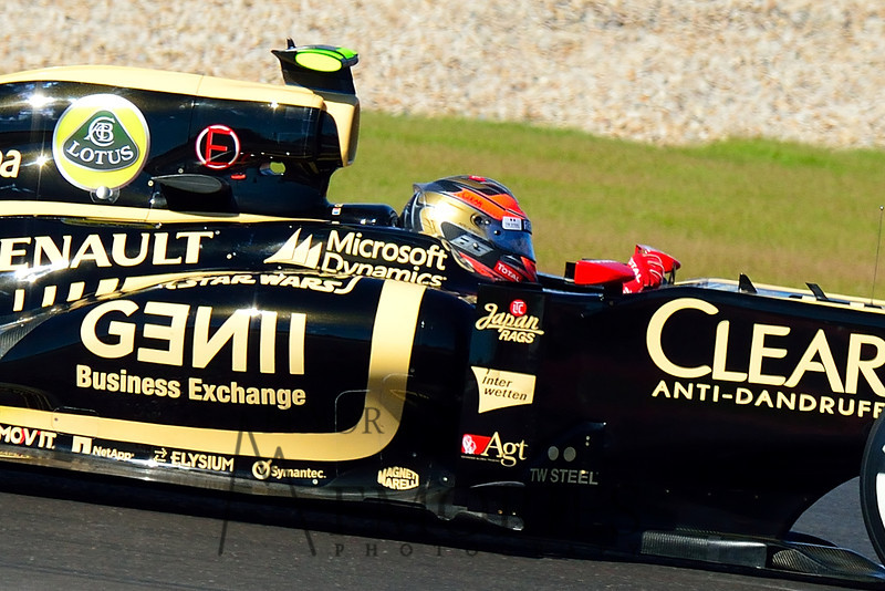 Romain Grosjean in the #10 Lotus