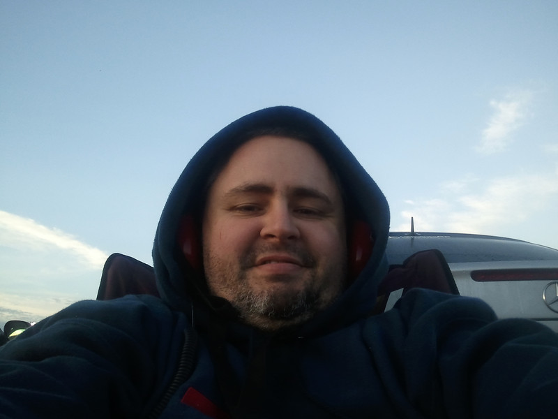 Me sitting in my chair behind the car shortly after the sun came up