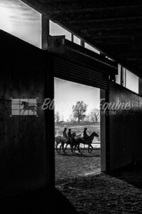Exercise Riders walking past roll up door on track, early morning 11.23.18 at The Toroughbred Training Center, Lexington Kentucky. Photo by Laura Palazzolo