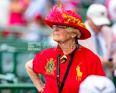 Louisville, KY - MAY 4: an older woman wears a red flowered hat on Oaks Day at Churchill Downs  Race Course on May 4, 2018 in Louisville, KY