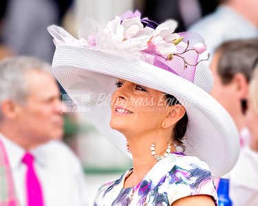 Louisville, KY - MAY 4: a woman wears a purple flowered hat on Oaks Day at Churchill Downs  Race Course on May 4, 2018 in Louisville, KY