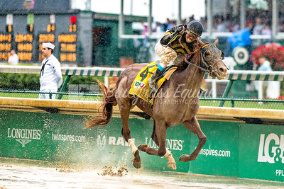 Brian Hernandez celebrates as Funny Duck (Distorted Humor) takes the lead to win the Pat Mile (G3) on Derby Day. Brian Hernandez, Jr up, trained by George Arnold and owned by Calumet Farm.
