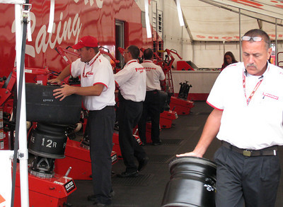 Firestone guys putting on tires for the cars.
