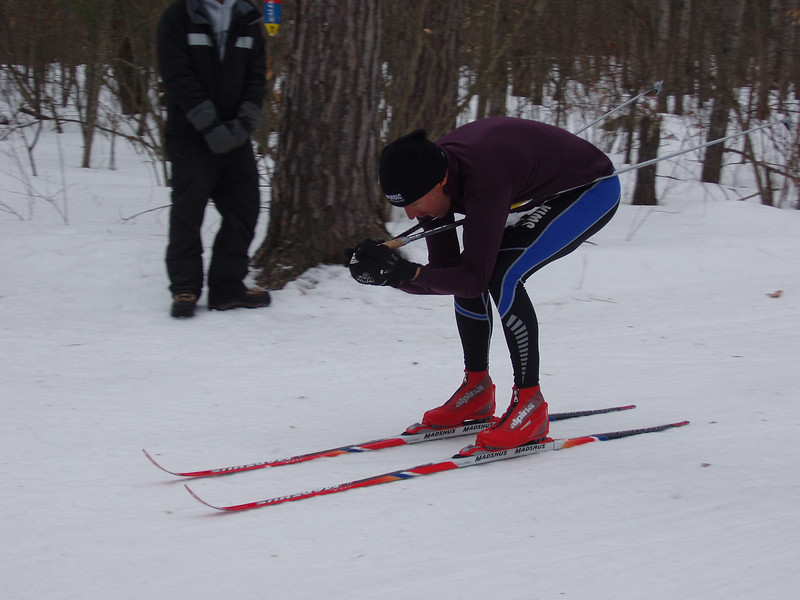 Hugh Pritchard (Team NordicSkiRacer.com) is the first skier to complete the Rolling Hills trail section.