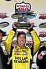 Kyle Busch hoists the winner's trophy for the Lucas Oil 150 NASCAR Craftsman Truck Series race.