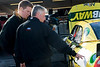 Carl Edwards' crew chief Bob Osborne goes over a pre-race check list with a crew member.