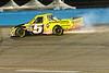 The truck driven by Travis Kvapil leaves a trail of sparks after hitting the wall going into turn 4.