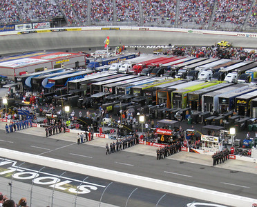 Pit crews lined up for the National Anthem.