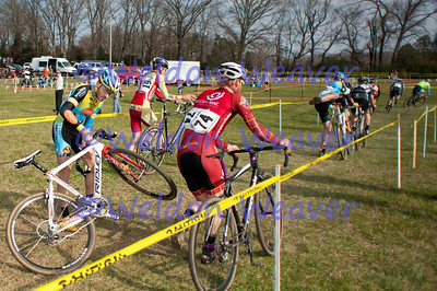 Jon Hamblen gets crossed-up over the barriers.  North Carolina Cyclo-cross Series -  NCCX Race #8 - Sun. December 4, 2011 - Statesville, NC. Photo by Weldon Weaver.