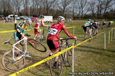 Jon Hamblen gets crossed-up over the barriers.  North Carolina Cyclo-cross Series -  NCCX Race #8 - Sun. December 4, 2011 - Statesville, NC. Photo by Weldon Weaver.