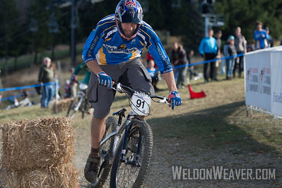 Phil Cowan of Fort Lewis College,  takes the bronze medal in the Division 1 dual slalom race.  USA Cycling Collegiate Mountain Bike National Championships Oct. 27 - Beech Mountain, NC.  Photo by Weldon Weaver.   Select and share.