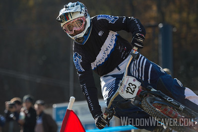 John Swanguen of Lindsey Wilson College takes the Division 1 dual slalom silver medal.  USA Cycling Collegiate Mountain Bike National Championships Oct. 27 - Beech Mountain, NC.  Photo by Weldon Weaver.   Select and share.
